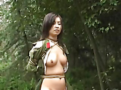 Chinese army girl tied to tree 3
