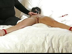 Tied girl with dripping wet pussy oily body hard nipples